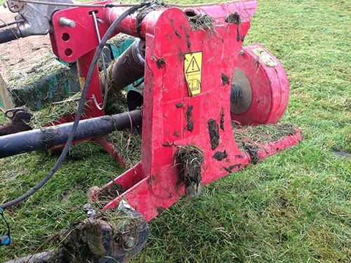 Photo of a dirty mower due to post graze topping of grass